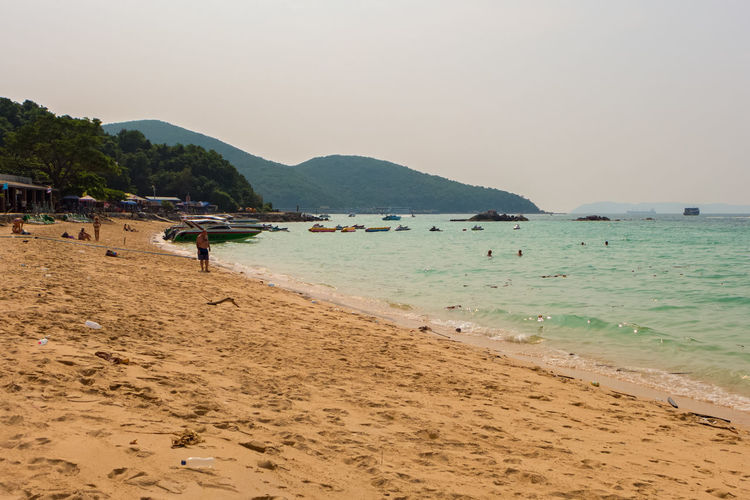 KOH LARN,THAILAND - OCTOBER 18,2016: The beach This island is in the Pattaya area and it has some beaches,which are popular among tourists from China and Russia. ASIA Thailand Beach Beauty In Nature Clear Sky Day Island Koh Larn Large Group Of People Leisure Activity Lifestyles Men Mountain Mountain Range Nature Outdoors People Real People Sand Scenics Sea Shore Sky Tranquil Scene Tranquility Vacations Water