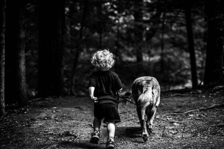 Beautiful friendship Bestfriends EyeEm Nature Lover EyeEm Best Shots Blackandwhite Walking The Dog Boy And His Dog Dogs Of EyeEm Friendship