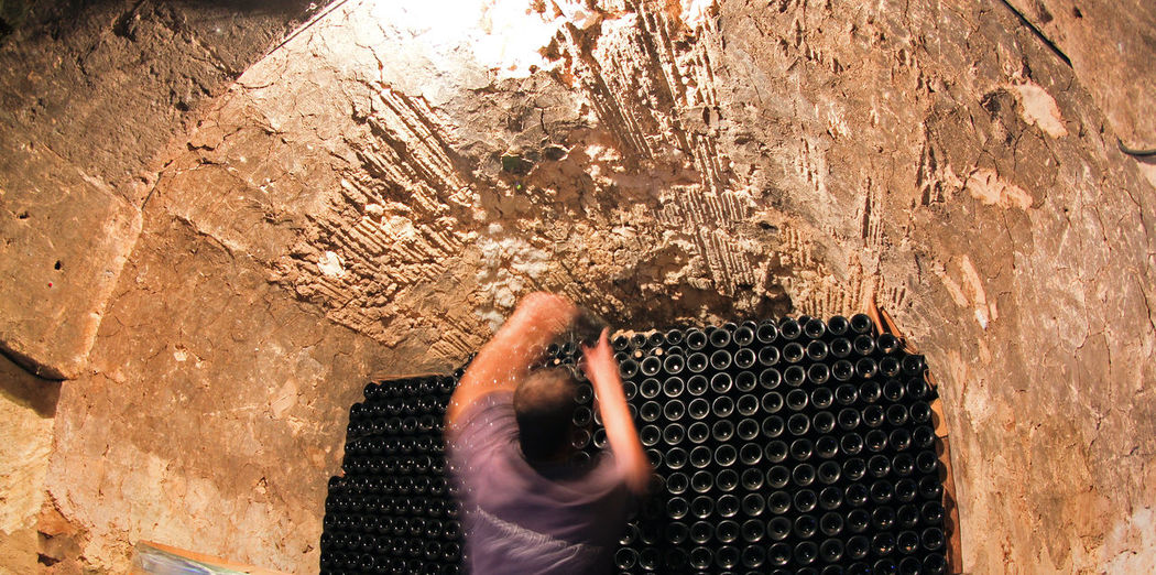 Blurred motion of man working at wine cellar