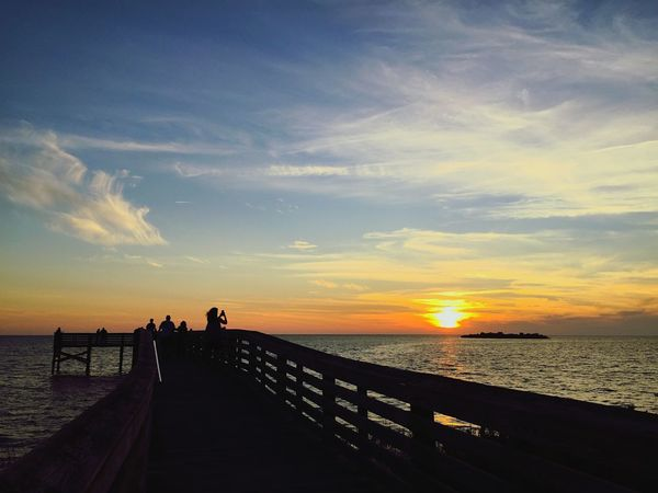 Looking Into The Future Portrait Of America Sunset Taking Photos Of People Taking Photos Nature EyeEm Best Shots Eye4photography  Open Edit Waterfront Sea And Sky Seascape Seaside People Beach Beauty In Nature Cloud - Sky Pier Manmade Structure