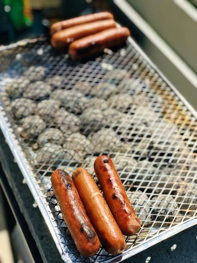 High angle view of sausages on barbecue grill