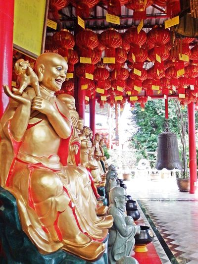 Bell God Light Red China Chrine Day No People Outdoors Place Of Worship Red Light Religion Sculpture Spirituality Statue