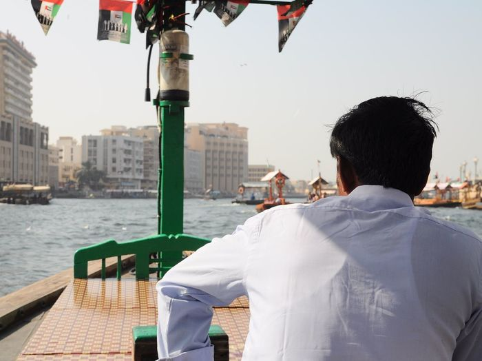 Dec'16: a boat ride across Dubai Creek- Bur Dubai Abra Station (Dubai, UAE) Abra Bur Dubai Dubai Dubai Creek Dubai❤ Middle East UAE UAE , Dubai United Arab Emirates Architecture Building Exterior Built Structure City Cityscape Day Dubaicity Leisure Activity Lifestyles Nautical Vessel Outdoors Real People Rear View River Sky Water EyeEmNewHere Mobility In Mega Cities