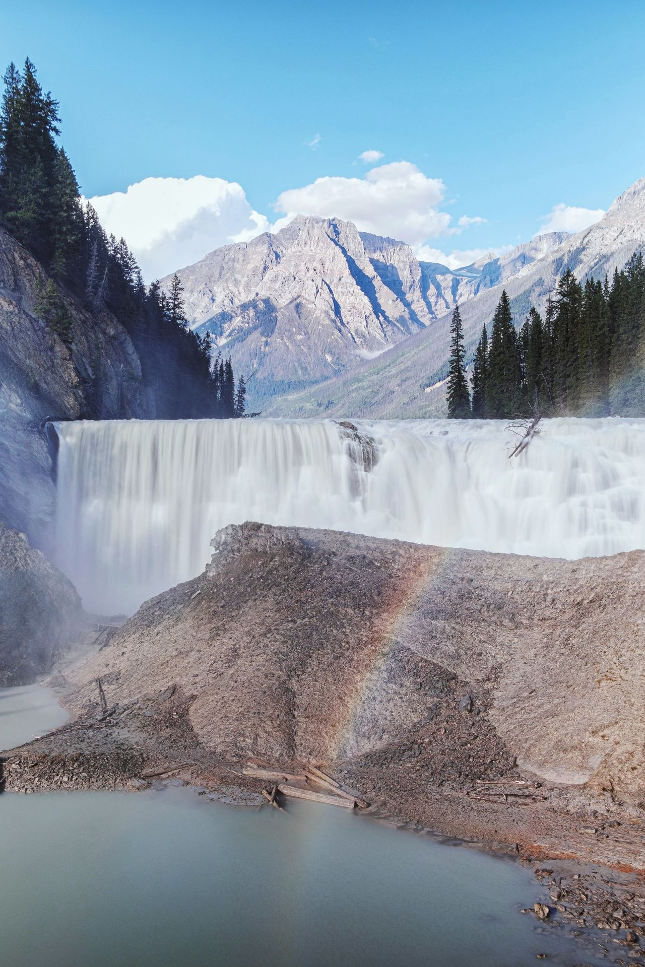 Blurred motion of waterfall against mountains