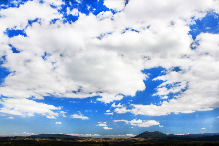 Low angle view of cloudy sky over land