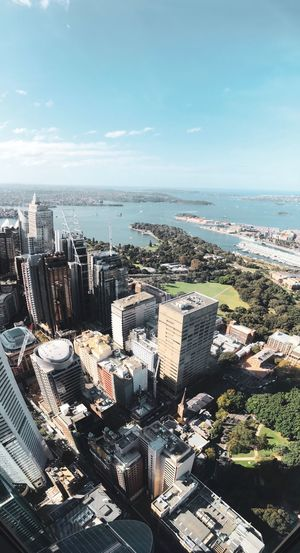 1/3 skyscrapers, 1/3 trees, 1/3 sea. Sydney Australia Architecture Building Exterior City Built Structure Sea Cityscape Water Sky Building Nature High Angle View Day Beach Horizon Office Building Exterior
