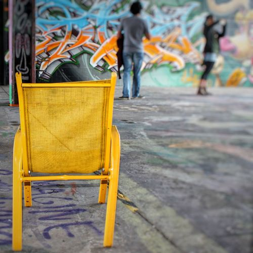 Paint The Town Yellow People Outdoors Yellow Adult Human Body Part Day Chair Close-up Berlin Photography Discover Berlin Graffitiart