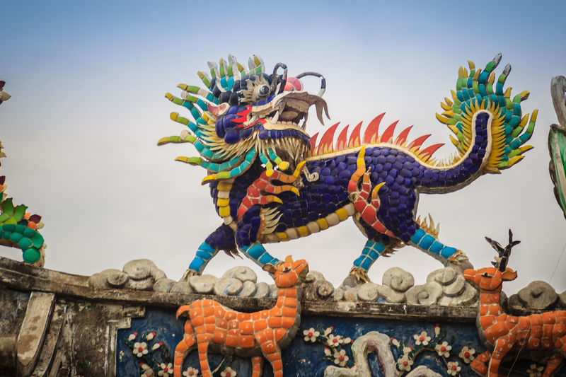 Chinese dragon-headed unicorn statue on the temple roof. Kylin or Kirin on roof in Chinese temple. Chinese Temple Ancient Architecture Dragon Sculpture Kirin Statue Kylin Temple Roof Architecture In Thailand Unicorn Unıcorn Animal Representation Architecture Art And Craft Chinese Dragon Chinese Temple Chinese Temple Decoration Chinese Temples Clear Sky Craft Creativity Day Dragon Dragon Head Dragon Scale Dragon Scales Dragon Statue Dragon Statues Kirin Kyline Low Angle View Multi Colored Nature No People Ornate Outdoors Representation Sculpture Sky Statue Temple Roof Temple Roof Tile Temple Roofs Unicorns
