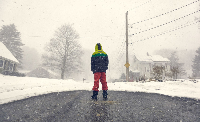 Winter Rear View Snow Real People One Person Cold Temperature Architecture Full Length Built Structure Nature Warm Clothing Clothing Day Building Exterior Transportation Lifestyles Snowing Road Outdoors Extreme Weather Hood - Clothing Boy