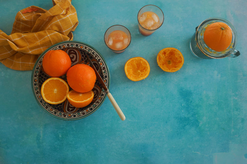 fresh squeezed orange juice Turquoise Colored Still Life Orange Color Orange Orange - Fruit Orange Juice  Juice Juicy Freshness Freshness Healthy Table High Angle View Sweet Food Food And Drink Citrus Fruit Orange - Fruit Juicer Sour Taste Vitamin C Halved Fruit Juice Blended Drink