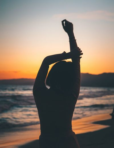 Mood Sunset Sky Orange Color Silhouette Water One Person Sea Beauty In Nature Real People Nature Beach Scenics - Nature Adult Leisure Activity Lifestyles Women Land Horizon Over Water