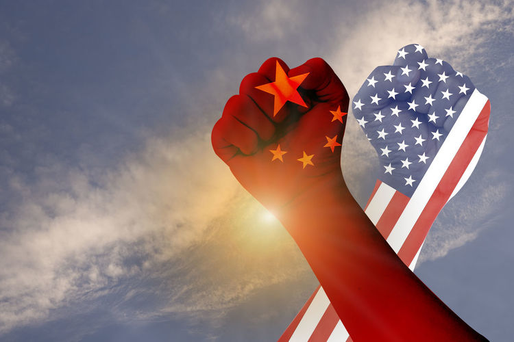 Across of hands of USA flag and China flag. It is symbol of tariff trade war which both countries increase tax barrier for export and import product. America Background Banner Barrier Battle Business China Commerce Competition Conflict Crisis Defeat Design Dispute Dollar Economy Emblem  Exchange Export Fight Financial Flag Global Government Import Industry Investment Loss Money Negotiations Patriotism Policy Politics Protectionism RISK Rmb Sign Surplus Symbol Tariff Tax Trade United Us USA Versus Vs War World YUAN