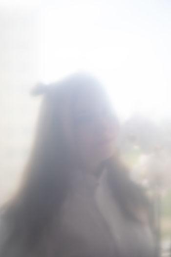 Defocused image of woman against sky