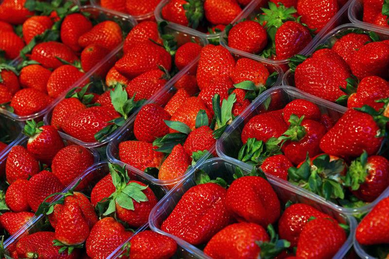 Full frame shot of strawberries for sale at market