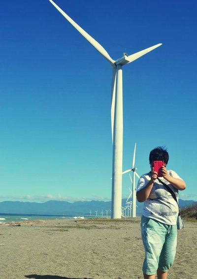 Windmill Travel Destinations Travel Sister Clear Sky Day Sky EyeEmNewHere Ilocos Sustainable Energy Energy Supply Wind Power Philippines Windmill Wind Turbine Casual Clothing The Traveler - 2018 EyeEm Awards The Fashion Photographer - 2018 EyeEm Awards The Great Outdoors - 2018 EyeEm Awards Tourist Attraction  Famous Place Coast Tourism Renewable Energy Turbine Shore