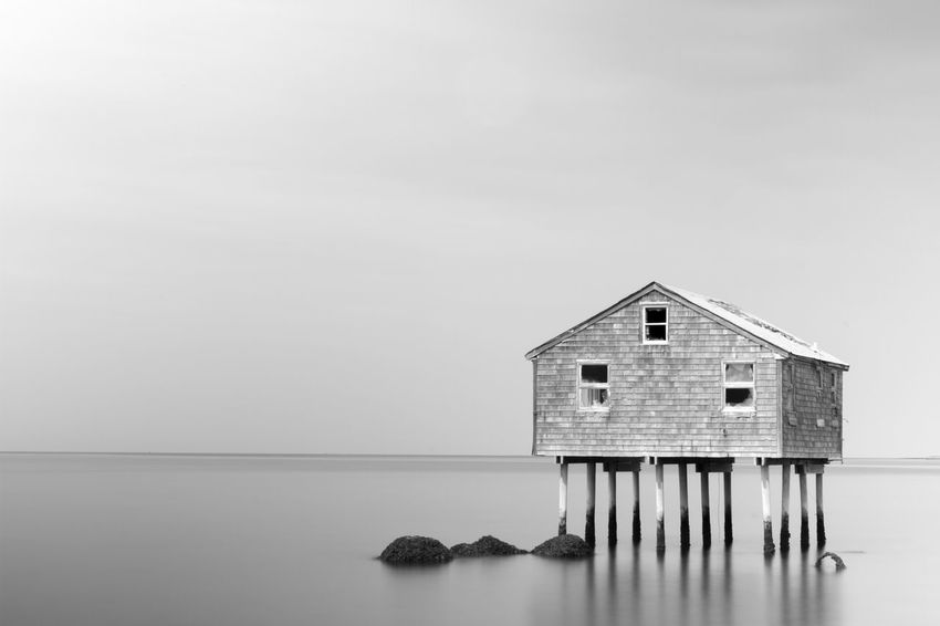 House on stilts slowly be taken by the sea in East Hampton, Ny. Architecture East Hampton New York Architecture Blackandwhite Built Structure Climate Change Day Long Exposure No People Outdoors Sea Sea And Sky Seascape Sky Water