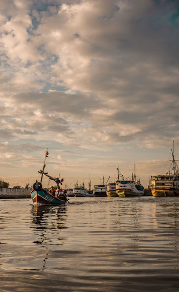 Sunset Jakarta EyeEm Nautical Vessel Sea Sunset Water Oil Pump Environment Sky Landscape Travel Cloud - Sky Fishing Boat Fisherman Commercial Fishing Net Fishing Industry Fishing Equipment Fishing Rod Wooden Post