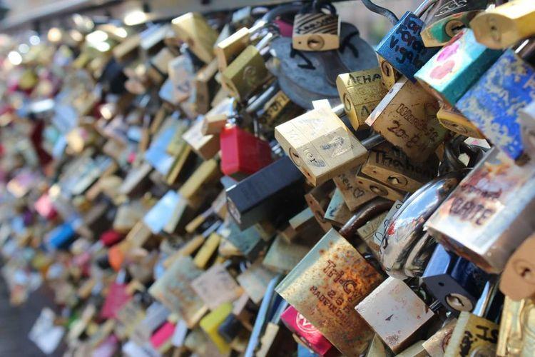 Close-Up Of Love Locks On Railing At Pont Des Arts