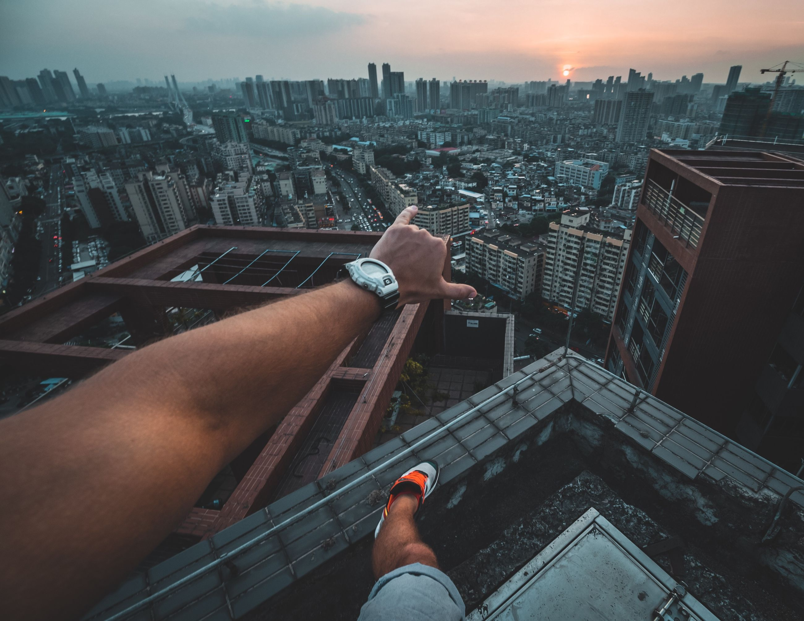 architecture, built structure, city, building exterior, cityscape, real people, one person, sky, hand, human hand, lifestyles, building, high angle view, human body part, men, personal perspective, nature, outdoors, residential district, office building exterior, skyscraper