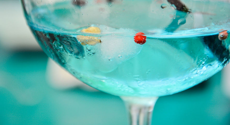 Close-up of blue drink in glass