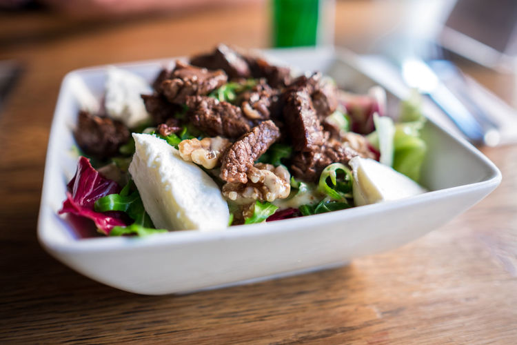 Close-up of beef cheese salad in bowl on table
