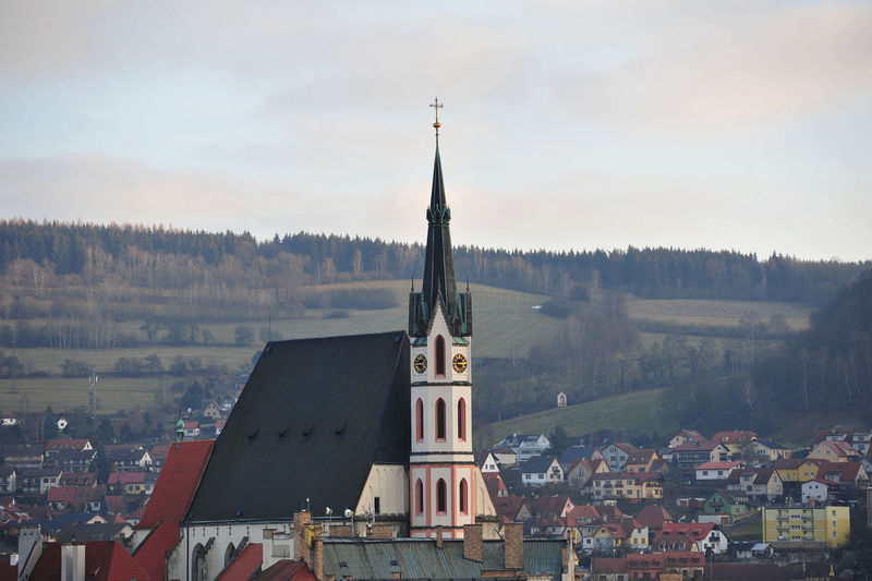 Church Against Houses In Town At Dusk