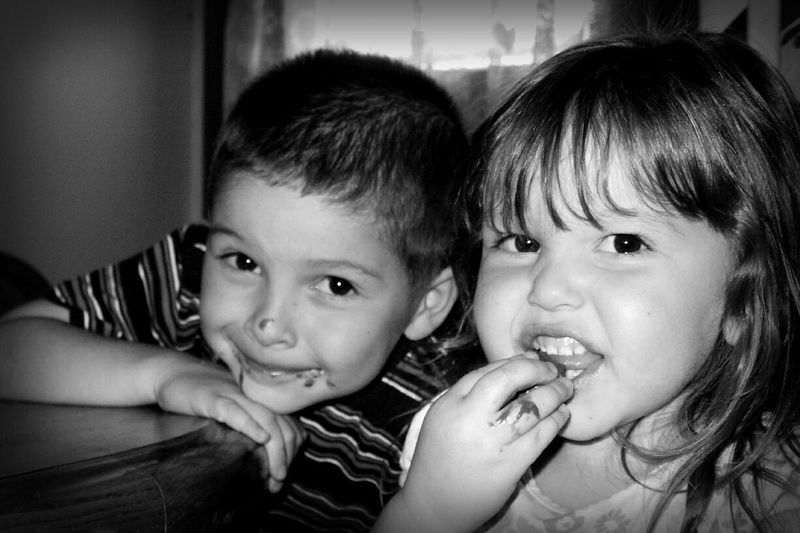 Portrait Of Happy Siblings At Home