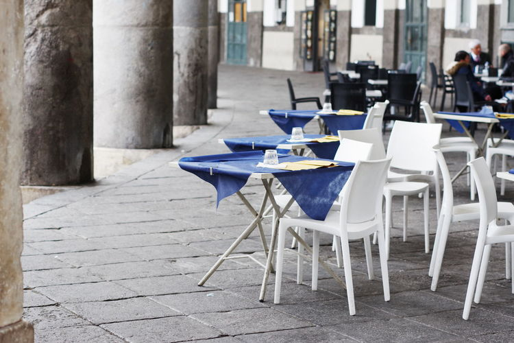 Table Chair Restaurant Business Seat Cafe Day Incidental People Architecture Absence Built Structure Food And Drink Building Arrangement Focus On Foreground Sidewalk Cafe Outdoors Empty City Glass Setting Columns Italy