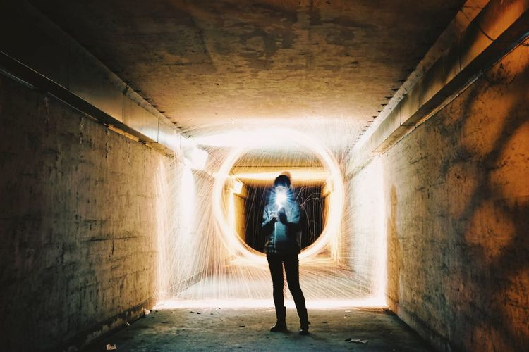 Light Painting Flashlight Fireworks Light Full Length Tunnel One Person Indoors  Standing Women One Woman Only Real People Exercising Architecture Lifestyles