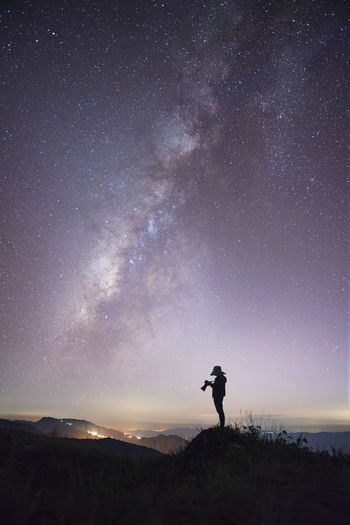Woman watching the milky way in the most beautiful time