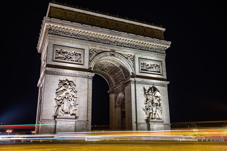 Night Triumphal Arch Light Trail Blurred Motion Motion Speed Architecture From My Point Of View EyeEm Best Shots History Illuminated Arch Low Angle View Monument Travel Destinations Sculpture Statue Built Structure Outdoors Road City