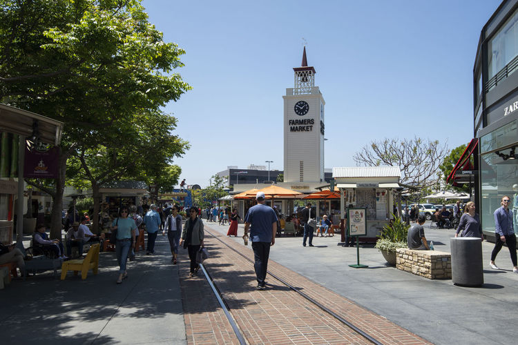 Clock tower at the entrance of Farmer's Market, Los Angeles Food Marketplace Market Complex People Square Town Street Old Shops Farmer Garden Eateries Tourists Editorial  Vegetable Clock Tower The Original Farmers Market Morning Summer Meat Fresh Blue Sky Sunny Afternoon City Exterior Building Landmark Decoration Architecture Business Downtown Attraction Outdoors Urban Travel Tourism Tower Historic USA Farmer's Market United States California Los Ángeles Famous