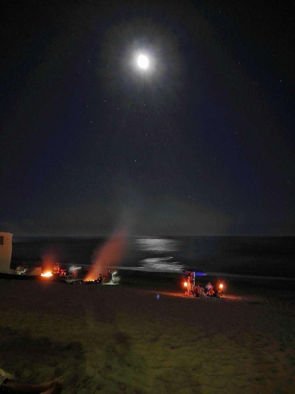 night, illuminated, burning, flame, outdoors, motion, sky, nature, no people