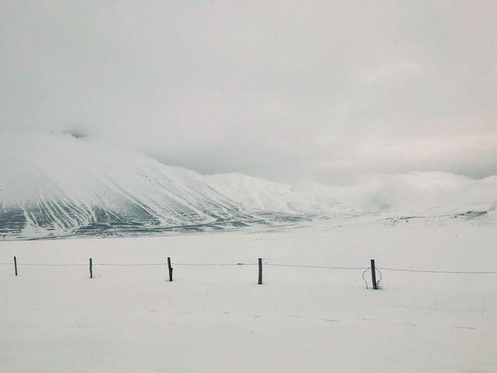 Scenics - Nature Snow Beauty In Nature Cold Temperature Winter Mountain Sky Landscape Non-urban Scene Snowcapped Mountain Day Environment