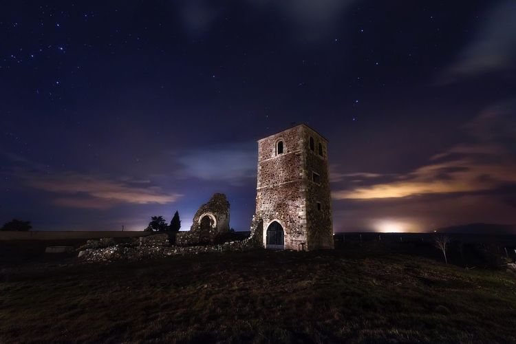 EyeEmNewHere Sky Night Building Exterior Old Ruin Architecture Outdoors No People Cloud - Sky Medieval Spainish Architecture, Spain Nightphotography Religion Church Abandoned Landscape Dramatic Sky Built Structure