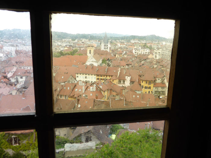View through a window Annecy, France Architecture Building Exterior Built Structure City Cityscape Day Indoors  Landscape Looking Through Window Nature No People Sky Tree View From Above View Through The Window Window Yellow Tones