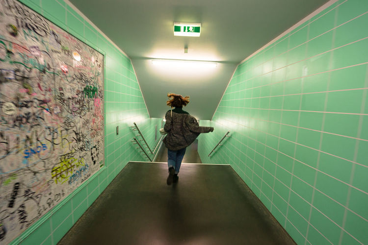 Day Green Color Illuminated Indoors  One Person Place Of Heart Real People Rear View Subway Technology