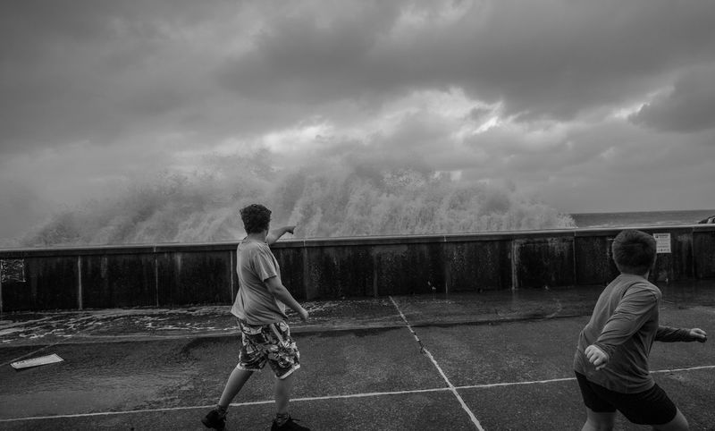 Spring Tides @ Cheyene car park Ilfracombe Perspectives On Nature Stormy Weather Black And White Black And White Photography Boys Childhood Cloud - Sky Lifestyles Nature Ocean Waves People Playing Real People Storms Waves, Ocean, Nature
