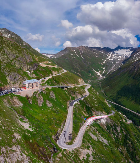 High angle view of road amidst mountains against sky