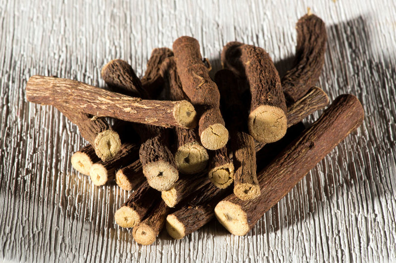 Dried licorice sticks made from the sweet flavored roots of the Glycyrrhiza glabra plant used as a flavoring in cooking and candy cut to lengths and arranged in a pile Herb Liquorice Natural Plant Aromatic Dried Flavoring Food And Drink Glycyrrhiza Glabra Healthy Eating Herbal Medicine Licorice Licorice Stick Root Taste