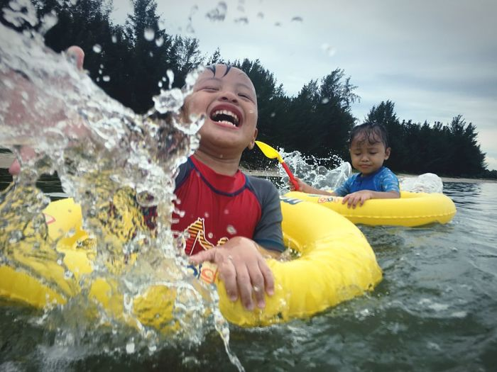Happy boy playing in water