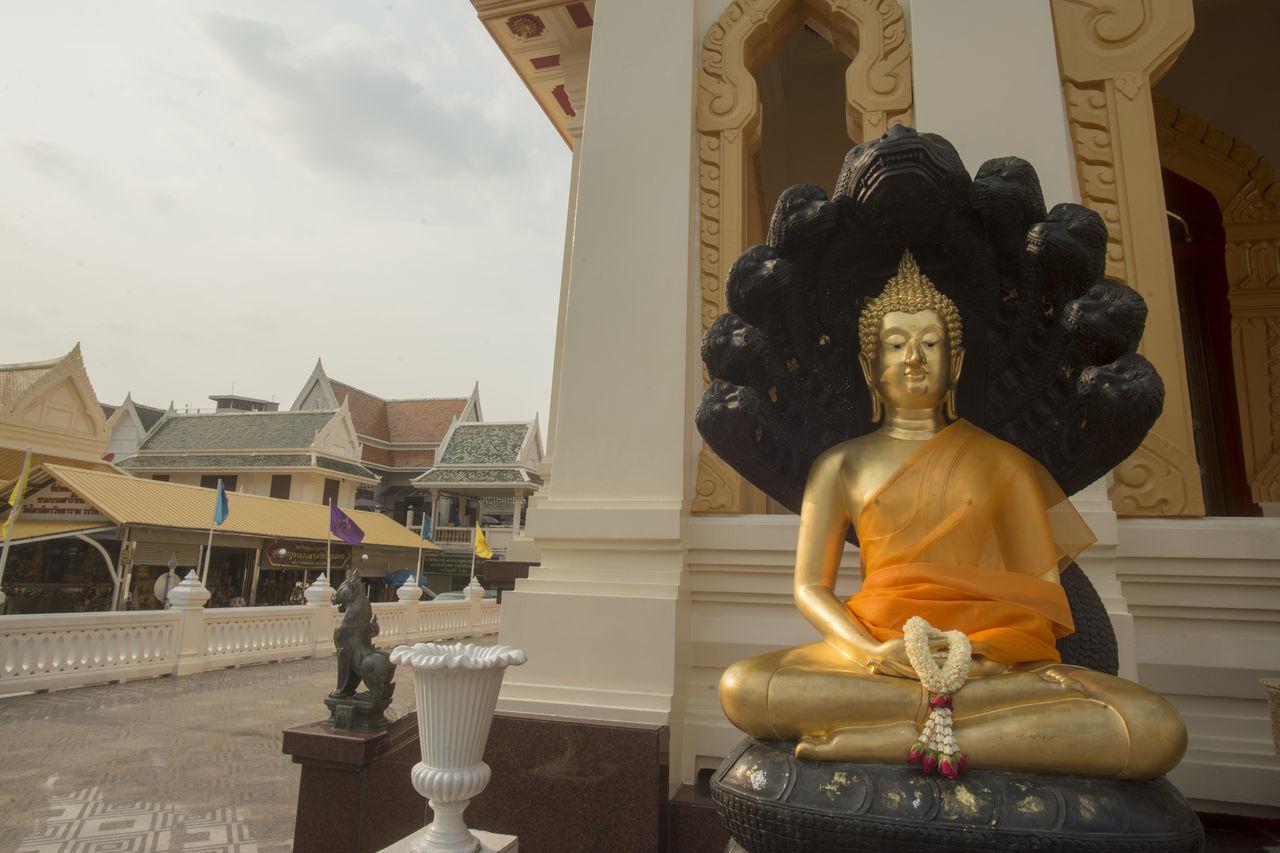 Gold Colored Buddha Statue In Temple