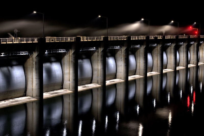 Reflection of illuminated railing in water