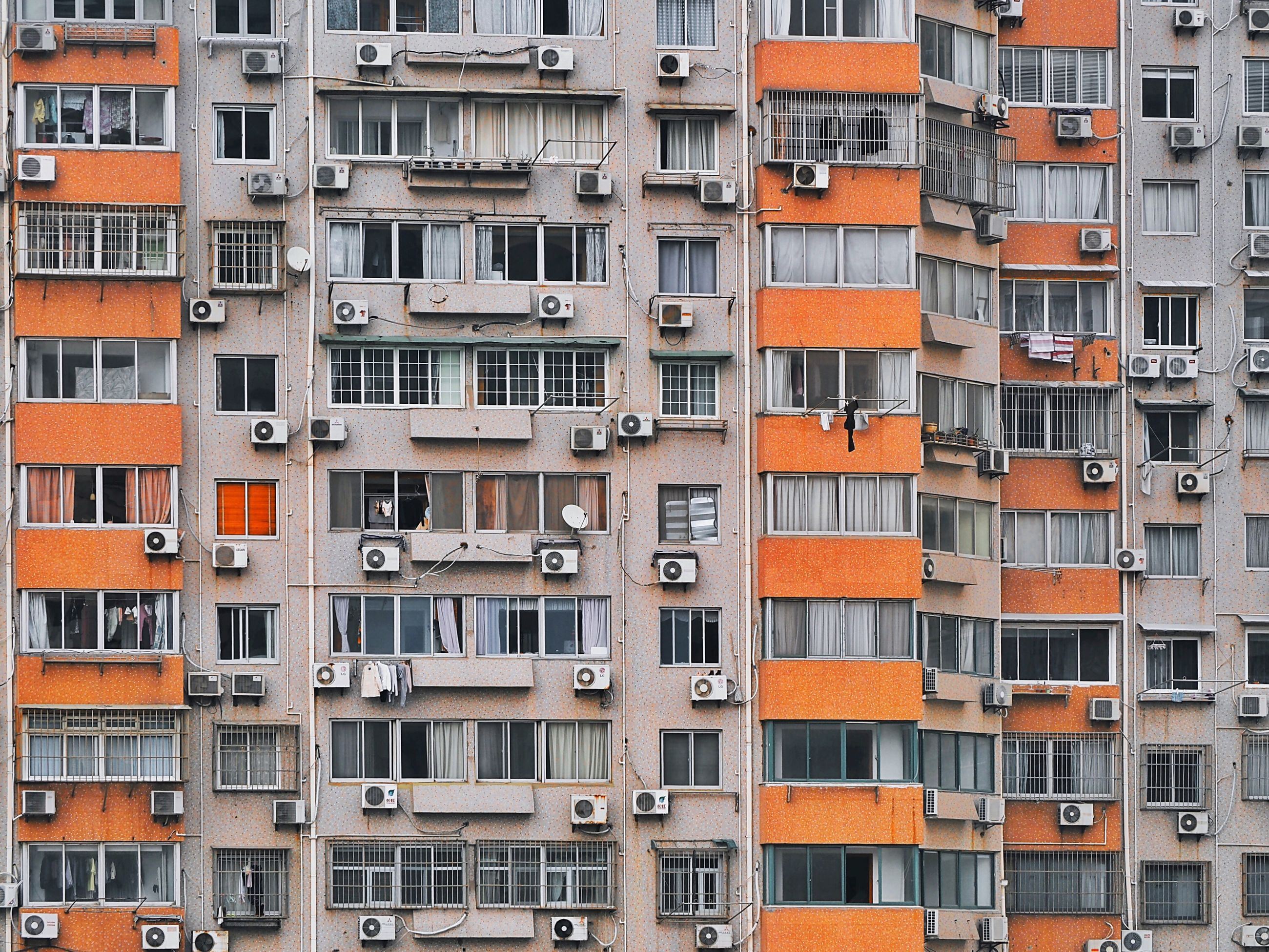 building exterior, architecture, built structure, full frame, window, backgrounds, city, residential building, building, residential structure, repetition, low angle view, apartment, balcony, in a row, modern, day, no people, outdoors, city life