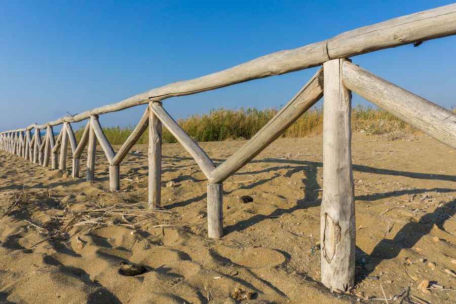 Clsoe-up of a wooden railing at the Beach Dunes Holiday Nature Railing Tranquility Travel Beach Blue Sky Close-up No People Outdoor Sand Scenics Summer Vacation Wood - Material Wooden Wooden Railing