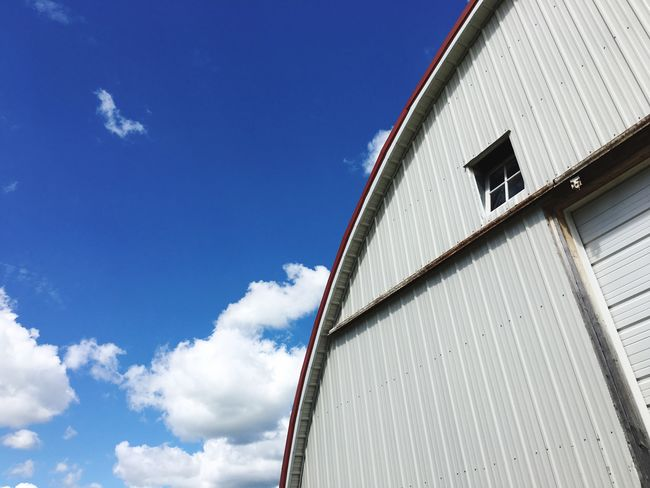 EyeEm Selects Built Structure Building Exterior Architecture Sky Day Low Angle View Outdoors No People Cloud - Sky Blue Corrugated Iron Iowa Iowa Farms Barn Northeast Iowa