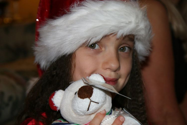 Close-up portrait of cute girl holding stuffed toy