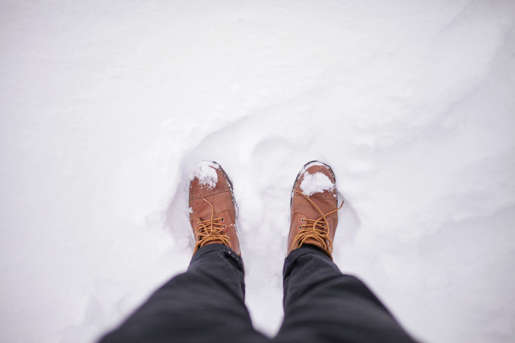 Winter boots on icy ground. Low Section Human Leg Shoe Personal Perspective Body Part Real People Day Snow Winter Men Unrecognizable Person Standing High Angle View Cold Temperature Lifestyles Outdoors Human Limb Human Foot Jeans Leather Ice Boots Winter Boots