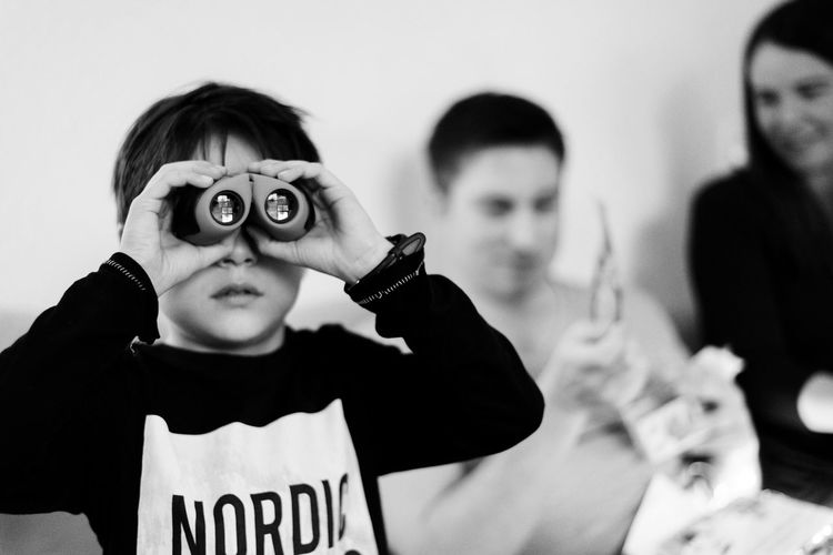 Black & White Unusual Weird Binoculars Black And White Blackandwhite Boys Casual Clothing Child Childhood Day Focus On Foreground Front View Holding Home Interior Indoors  Leisure Activity People Playing Real People Sibling Togetherness Visual Creativity