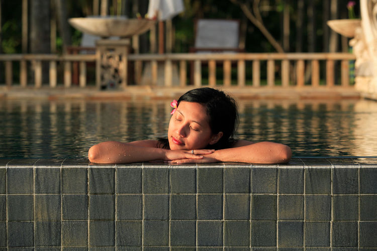 Woman with closed eyes in swimming pool